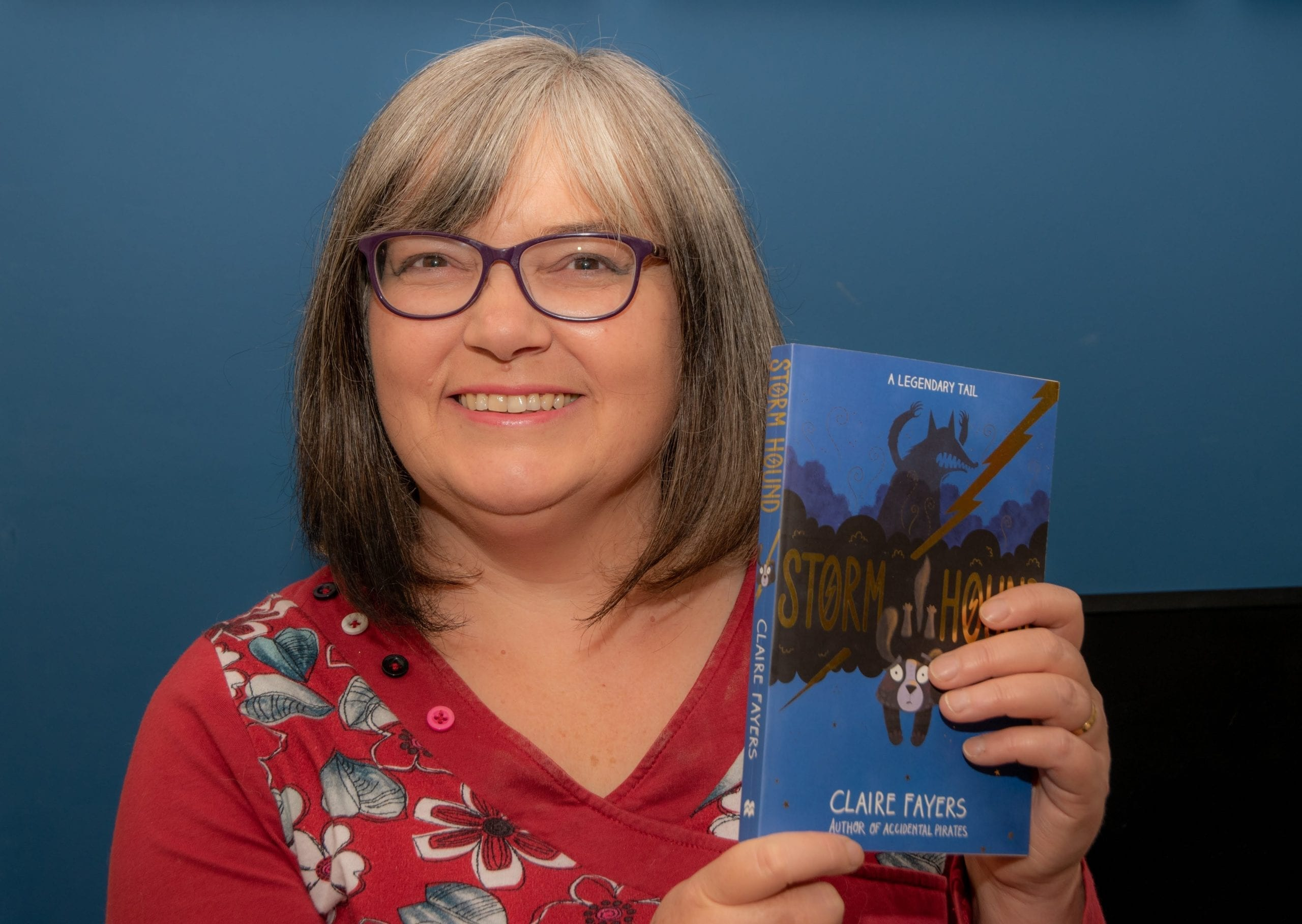 Claire Fayers holding a copy of her novel Storm Hound which won the English-language prize in the Tir na n-Og Awards 2020